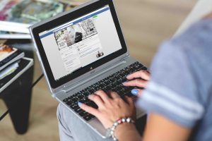 Social Media Marketing Specialist checking out Facebook Page