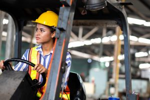 A femal Civil Engineer wearing a Protective head gear