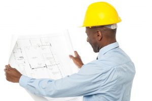 A Civil Engineer holding a building plan